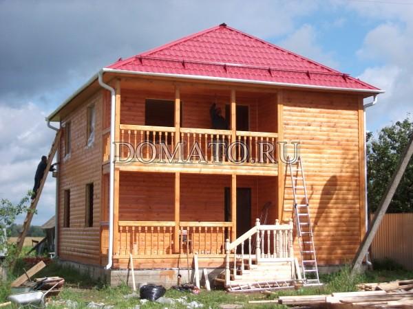дом из бруса с карнизом