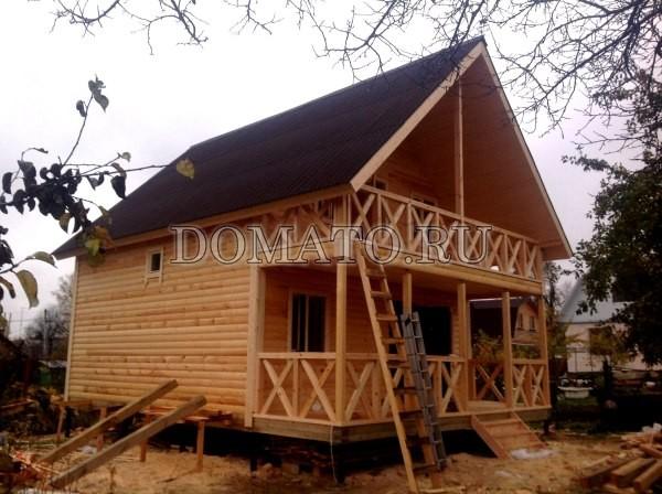 деревянный дом из бруса с террасой 7 на 9